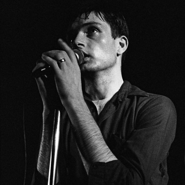 Singer Ian Curtis (1956 - 1980) performing with English rock group Joy Division at the Russell Club, also known as The Factory, Manchester, 13th July 1979. (Photo by Kevin Cummins/Getty Images)